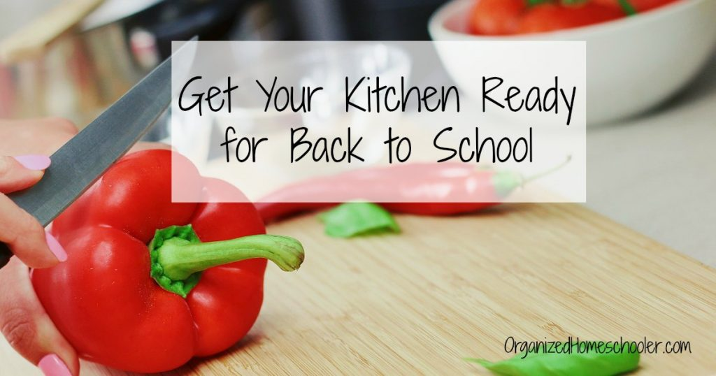 Woman slicing peppers to get her kitchen prepared for back to school